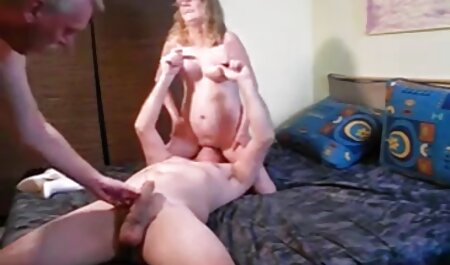An old full hd porn movies woman is surprised by a man with a hand wearing the glove